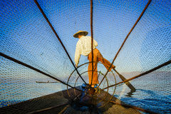 Silhouette fishermen in Inle Lake at sunrise, Shan State, Myanma Stock Images
