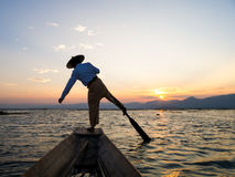 Silhouette fishermen in Inle Lake at sunrise, Shan State, Myanma Stock Photography