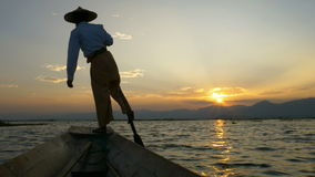 Silhouette fishermen in Inle Lake at sunset, Shan State, Myanmar stock footage