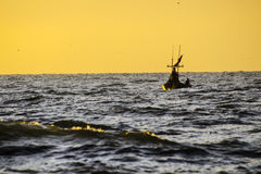 Silhouette of fishermen  in the morning Stock Photography