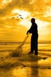 Silhouette of fishermen Royalty Free Stock Image