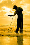 Silhouette of fishermen repair his nett Royalty Free Stock Photo