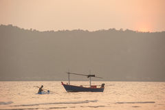 Silhouette of fishermen with  sunset in the background Stock Images