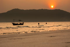 Silhouette of fishermen with  sunset in the background Royalty Free Stock Photo