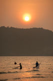 Silhouette of fishermen with  sunset in the background Royalty Free Stock Image