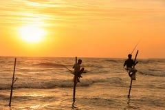 Silhouette of fishermen at sunset, Unawatuna, Sri Lanka Stock Photos