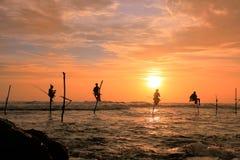 Silhouette of fishermen at sunset, Unawatuna, Sri Lanka Stock Image