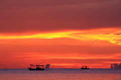 Silhouette of fishermen Stock Images