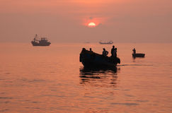 Silhouette of fishing boat Stock Image