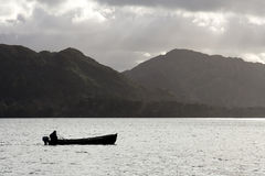 Silhouette of fishing boat Stock Photos