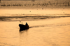 Silhouette the fishing boat Royalty Free Stock Photo