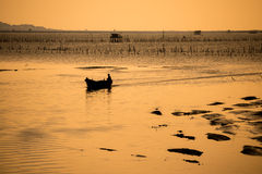 Silhouette the fishing boat Stock Image