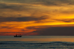 Silhouette of Fishing Boat on sunrise, HuaHin Thailand Stock Photos