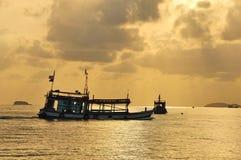 Silhouette of Fishing Boat on Sunrise Stock Image