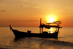 Silhouette of fishing boat. At sunset Royalty Free Stock Photos