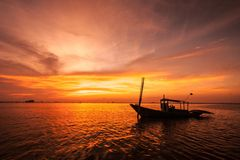 Silhouette of fishing boat. On sunset Royalty Free Stock Image