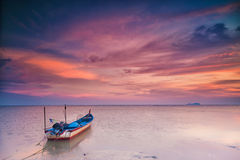 Silhouette of a Fishing Boat at sunset in Holiday Concept. Stock Image