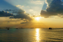 Silhouette of fishing boat and sunset, with  koh sichang and sri Stock Image