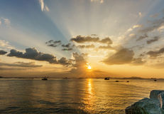 Silhouette of fishing boat and sunset, with  koh sichang and sri Stock Photography
