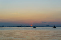 Silhouette of fishing boat and sunset, with  koh sichang and sri Royalty Free Stock Images