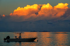 Silhouette of fishing boat at sunset on Taveuni Island, Fiji. Taveuni is the third largest island in Fiji Stock Images