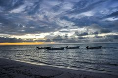 Silhouette of fishing boats off the coast of Isla Holbox, Mexico stock photos