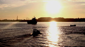 Silhouette Fishing boats out shore in sunrise. At samutprakan Thailand stock video footage