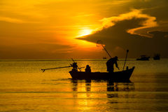 Silhouette of fishing and fisherman boat at the Sunrise in thailand Stock Photography