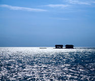 Silhouette fishing little house on the ocean Royalty Free Stock Images