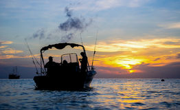 Silhouette of fishing man and a boate on sunlise at similand, Th Stock Image