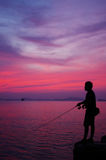 Silhouette of fishing man Royalty Free Stock Photos