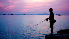 Silhouette of fishing man Royalty Free Stock Images