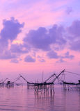 Silhouette fishing net trap at sunrise seascape Royalty Free Stock Photography
