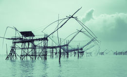Silhouette fishing net trap in Thailand Stock Photos