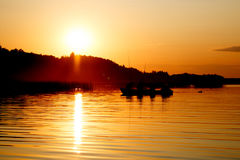 Silhouette of fishing people in boat Royalty Free Stock Photography