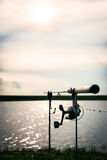 Silhouette of a fishing rod with focus on the reel Royalty Free Stock Photo