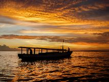 A fishingboat at sunset near Lombok, Indonesia. The silhouette of a fishingboat at sunset near Lombok, Indonesia Royalty Free Stock Photography