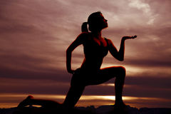 Silhouette fitness knee hand out Royalty Free Stock Photo