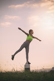 Silhouette fitness woman exercising at sunset time,. Vintage Effect Royalty Free Stock Photos