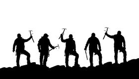 Silhouette of five climbers with ice axe in hand Royalty Free Stock Images