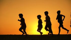 Silhouette of five kids family runniing at sunset stock video footage