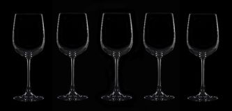 Silhouette of five wineglass. Isolated on black Stock Image