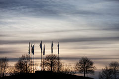 Silhouette of flags in sunset sky Stock Photo