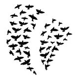 Silhouette of a flock of birds. Black contours of flying birds. Flying pigeons. Tattoo. Silhouette of a flock of birds. Black contours of flying birds. Flying Stock Images