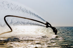 Silhouette of a fly board rider Stock Photos