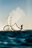 Silhouette of a fly board rider. At sea Stock Photo