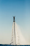 Silhouette of a fly board rider. At sea Royalty Free Stock Photography