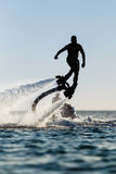 Silhouette of a fly board rider Stock Photography