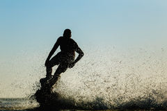 Silhouette of a fly board rider Royalty Free Stock Images