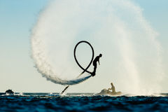 Silhouette of a fly board rider Royalty Free Stock Photo